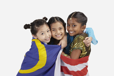 together standing: Happy girls with Malaysian flag wrapped around them