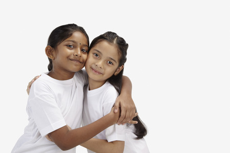 two people only: Girls hugging and smiling at the camera