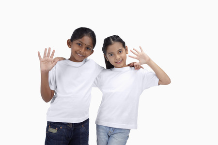 only two people: Girls smiling and waving at the camera LANG_EVOIMAGES