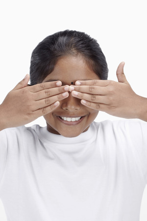 hands covering eyes: Girl covering her eyes with her hands LANG_EVOIMAGES