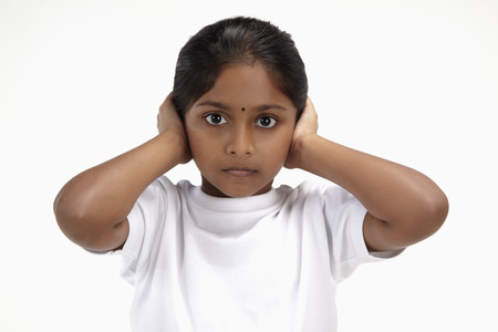 hands over ears: Girl with hands over her ears