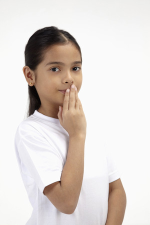 sensory perception: Girl with hands over her mouth