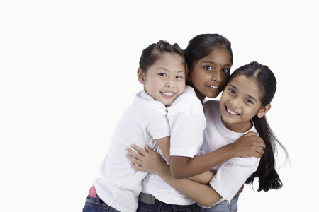 three people only: Girls hugging and smiling at the camera