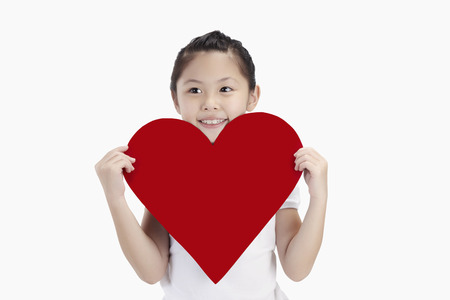 to cut out: Girl holding a big cut out heart