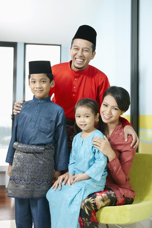 family with two children: Family in traditional clothing