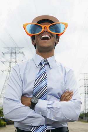 oversized: Young businessman wearing oversized sunglasses