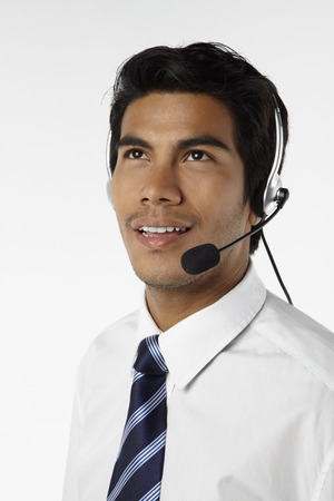 handsfree device: Young businessman wearing headset