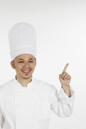 index finger: Asian chef gesturing with index finger LANG_EVOIMAGES