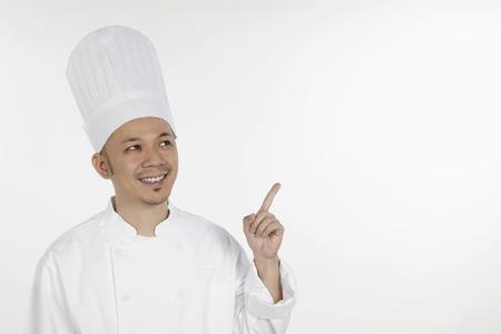 dedo �ndice: Cocinero asi�tico haciendo un gesto con el dedo �ndice