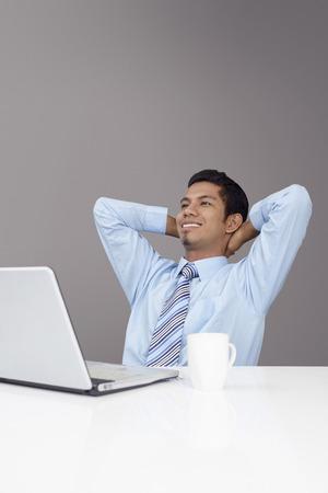 taking a break: Young businessman taking a break from work