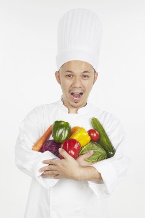 armful: Asian chef with an armful of vegetables LANG_EVOIMAGES