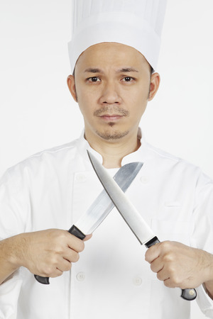 asian chef: A frustrated Asian chef with knives