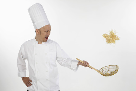asian chef: Asian chef tossing noodles
