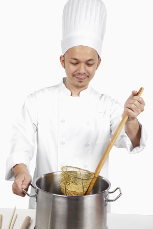 asian chef: Asian chef preparing noodles