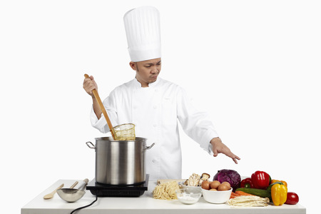 asian chef: Asian chef preparing a wholesome meal