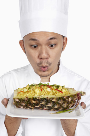 asian chef: Asian chef with a plate of Thai pineapple fried rice