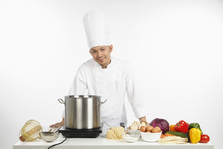 wholesome: Asian chef preparing a wholesome meal