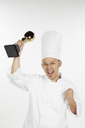 front raise: Asian chef holding trophy