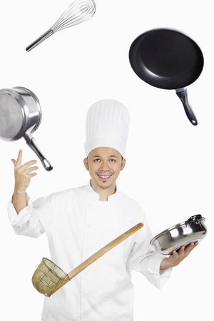asian chef: Asian chef juggling kitchen utensil