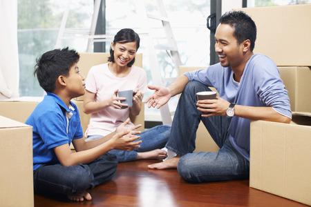 taking a break: Family taking a break in new house