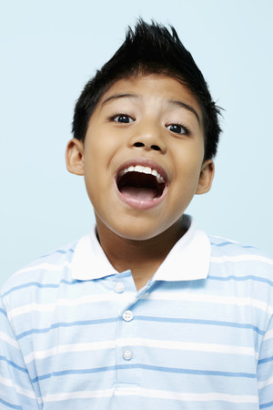 mouth opened: Boy with his mouth opened LANG_EVOIMAGES