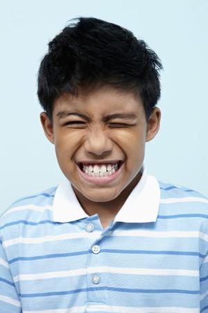 one eye: Boy with one eye closed