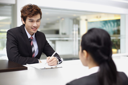 Sales representative interacting with a customer at the counter