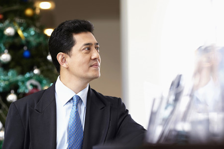 business: Businessman looking away in deep thought