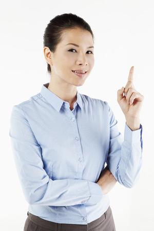dedo �ndice: Mediados de adultos de negocios la celebraci�n de su dedo �ndice