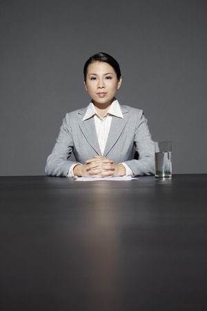 managerial: Mid adult businesswoman in meeting room