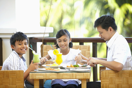 Man having lunch with son and daughter Stock Photo