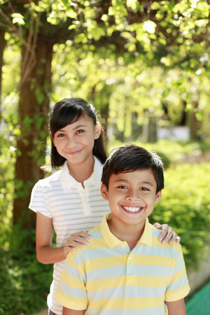 malay boy: Boy and girl together, smiling LANG_EVOIMAGES