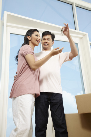 cardboard only: Man and woman moving into new house