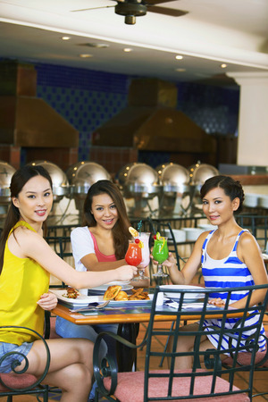 only three people: Friends having lunch together at restaurant