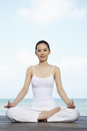 Woman meditating Stock Photo