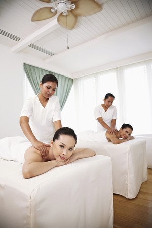 four person only: Women enjoying body massage