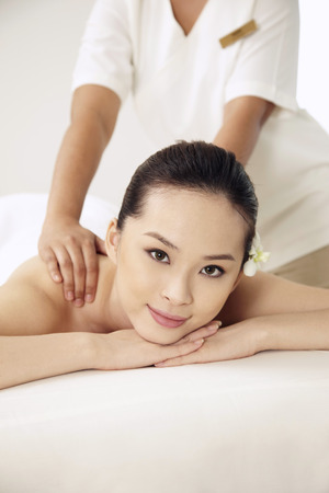 bare waist: Woman enjoying body massage
