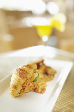 with fillings: Freshly baked croissant with fillings on plate