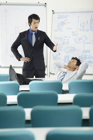 taking nap: Businessman being caught taking a nap LANG_EVOIMAGES
