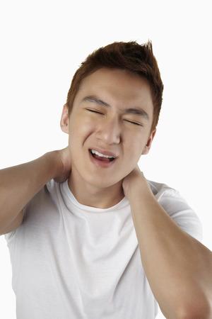 rubbing: Man rubbing sore neck LANG_EVOIMAGES