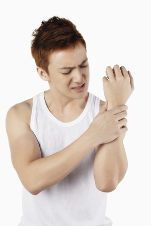 wrist pain: Man with wrist pain