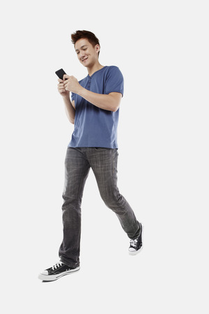 text messaging: Man text messaging on smart phone LANG_EVOIMAGES