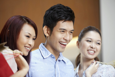 three people only: Women and a man smiling LANG_EVOIMAGES