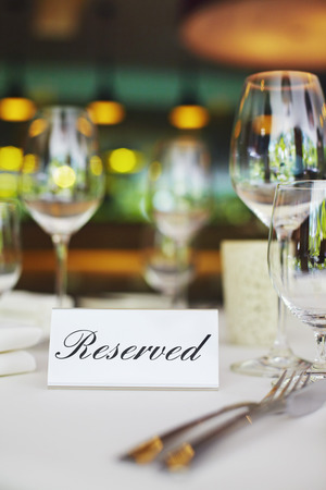 Restaurant table setting with reserved sign Stok Fotoğraf