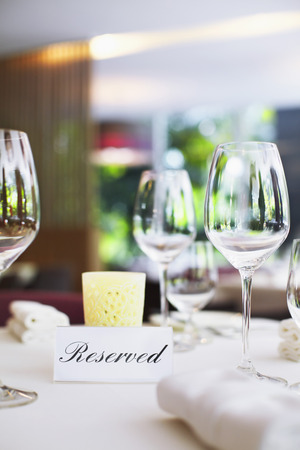 Restaurant table setting with reserved sign Stock Photo