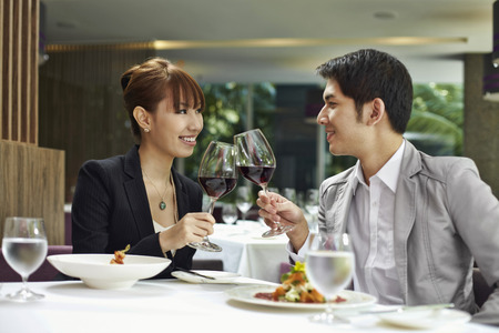 toasting wine: Man and woman toasting wine glasses