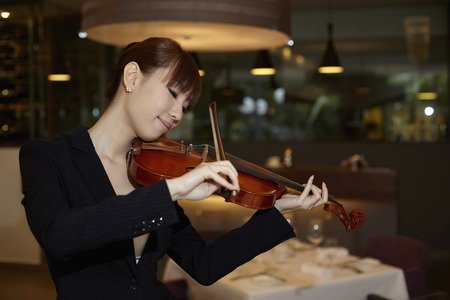 musically: Woman playing with a violin