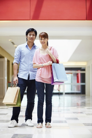 spending full: Man and woman carrying shopping items