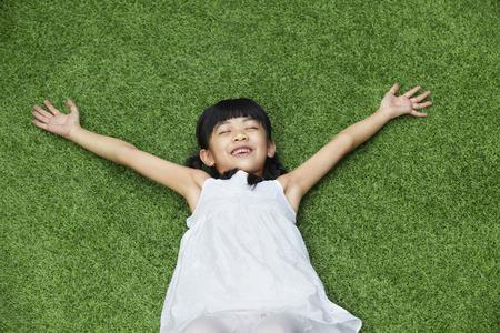 girl lying down: Girl lying down on the grass