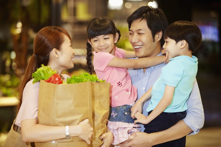 Family shopping for groceries together